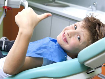 Young boy happy at dentist
