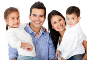 Happy family smiling thanks to family dentist in norwood