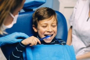 little boy in dental chair